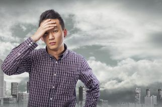 young asian man with problems, worry gesture