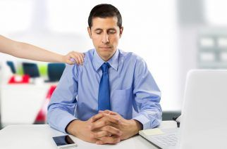 encouraging business woman clerk demotivated after a failure and discussion in the office